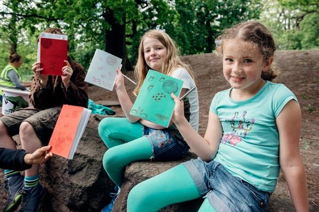 Transition Kids proudly presenting their field journals. © Stefan Ferreira