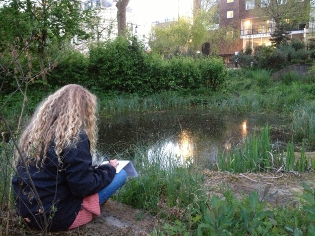 Katy Potts, an ID Trainee, surveying for newts in the Wildlife Garden