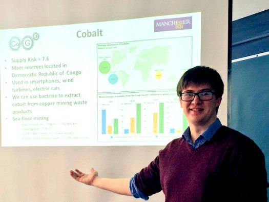 Photo of Ed in front of a whiteboard  presentation