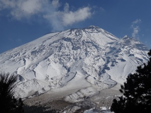 Photo showing the snow-capped peak of Popocatepetl volcano