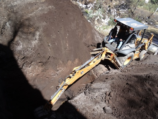 Photo showing the excavator having dug much deeper into the ground