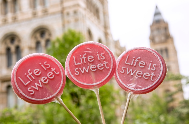Photo showing Life is sweet lollies with the Museum as a backdrop