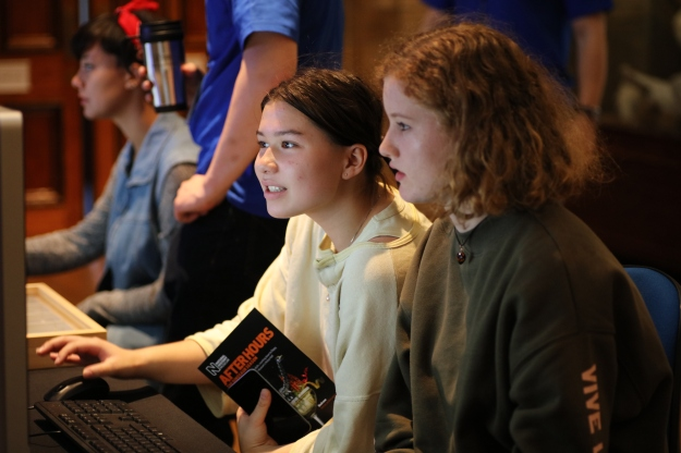 Photo showing two students working on a computer at the event