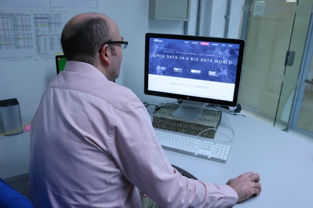 Photograph of Vince Smith, Head of Informatics reading the Science International Data Accord